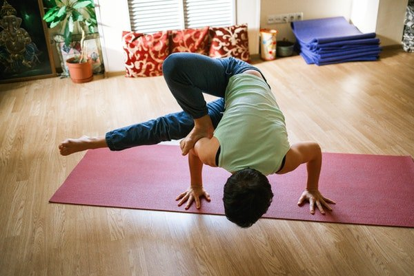 self care for parents - parental burnout - father practices yoga at home